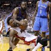 Oklahoma City\'s James Harden (13) fights for the ball with Miami\'s Udonis Haslem (40) during Game 4 of the NBA Finals between the Oklahoma City Thunder and the Miami Heat at American Airlines Arena, Tuesday, June 19, 2012. Oklahoma City lost 104-98. Photo by Bryan Terry, The Oklahoman