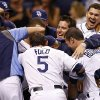Members of the Tampa Bay Rays mob Evan Longoria after his two-run walk-off home run during the ninth inning of an interleague baseball game against the San Diego Padres Saturday, May 11, 2013, in St. Petersburg, Fla. The Rays won 8-7. (AP Photo/Mike Carlson)