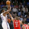 Oklahoma City\'s Kevin Durant is pressured by Houston\'s Shane Battier during their NBA basketball game at the OKC Arena in downtown Oklahoma City on Wednesday, Nov. 17, 2010. Photo by John Clanton, The Oklahoman