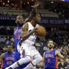 Charlotte Bobcats\' Kemba Walker (15) looks to pass as Detroit Pistons\' Greg Monroe (10) and Jose Calderon (8) defend during the first half of an NBA basketball game in Charlotte, N.C., Wednesday, Feb. 20, 2013. (AP Photo/Chuck Burton)