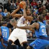 Oklahoma City\'s Kevin Durant (35) holds the ball between Jason Terry (31) and DeShawn Stevenson (92) of Dallas during the NBA basketball game between the Dallas Mavericks and the Oklahoma City Thunder at the Oklahoma City Arena in Oklahoma City, Monday, Dec. 27, 2010. Dallas won, 103-93. Photo by Nate Billings, The Oklahoman