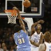NBA BASKETBALL: Kevin Durant blocks a shot by Nene in the first half as the Oklahoma City Thunder play the Denver Nuggets at the Ford Center in Oklahoma City, Okla. on Friday, January 2, 2009. Photo by Steve Sisney/The Oklahoman ORG XMIT: kod