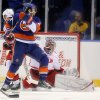 Carolina Hurricanes goalie Cam Ward (30) makes a save on a shot by New York Islanders left wing Matt Moulson (26) during the first period of an NHL hockey game at the Nassau Coliseum in Uniondale, N.Y., Monday, Feb.11, 2013. (AP Photo/Paul J. Bereswill)