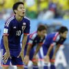 Photo - Japan's Shinji Kagawa pauses during the group C World Cup soccer match between Japan and Colombia at the Arena Pantanal in Cuiaba, Brazil, Tuesday, June 24, 2014. (AP Photo/Kirsty Wigglesworth)