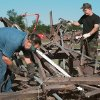 Tornado damage: Tinker Air Force Base. Stacy Thomas of Mustang and Staff Sgt. Willard Rogers cutting up the twisted bleachers at Tinker\'s football field and running track located on the west side of the base. (Note: Thomas is civil employee and Rogers is military but both are with the civil engineers)