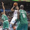Oklahoma City Thunder small forward Kevin Durant (35) shoots the ball between Boston Celtics shooting guard Avery Bradley (0) and Boston Celtics power forward Kevin Garnett (5) during the NBA basketball game between the Oklahoma City Thunder and the Boston Celtics at the Chesapeake Energy Arena on Wednesday, Feb. 22, 2012 in Oklahoma City, Okla. Photo by Chris Landsberger, The Oklahoman