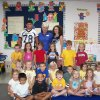 Edmond North High School PACT Pals visit with students at the elementary schools. PACT Pals are football players, cheerleaders and Pom Pon members who spend time with our elementary students several afternoons during football season. Brit Morris and Taylor Munholland spend time at John Ross with Mrs. Tansel's afternoon kindergarten class. Taylor was a student of Mrs. Tansel in the same class room in 1995. Brit is a varsity football player and Taylor is a member of the varsity Pom Pon team. Community Photo By: Carolyn Munholland Submitted By: Carolyn, Edmond