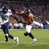 Photo -   Denver Broncos' Chris Harris (25) breaks up a pass intended for Seattle Seahawks' Terrell Owens (10) in the first half of an NFL football preseason game on Saturday, Aug. 18, 2012, in Denver. (AP Photo/Joe Mahoney)
