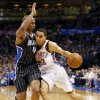 Oklahoma City\'s Kevin Martin (23) drives against Orlando\'s Arron Afflalo (4) during an NBA basketball game between the Oklahoma City Thunder and the Orlando Magic at Chesapeake Energy Arena in Oklahoma City, Friday, March 15, 2013. Photo by Nate Billings, The Oklahoman