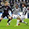 Photo - FC Copenaghen's Nicolai Jorgensen, challenges for the ball with Juventus Andrea Pirlo, right,  during the Champions League, Group B, soccer match between Juventus and FC Copenhagen at the Juventus stadium, in Turin, Italy, Wednesday, Nov. 27, 2013. (AP Photo/Massimo Pinca)