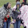 Golf fans huddle to stay warm during the 4A girl\'s sudden-death playoff golf match between Weatherford\'s Darby Morgan and Poteau\'s Hannah Ward at the Lake Hefner Golf course in Oklahoma City, OK, Thursday, May 2, 2013. Poteau won the top honor on the first hole. By Paul Hellstern, The Oklahoman