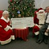 The inpatients at the J. D. McCarty Center were not the only ones to receive a gift from Mr. and Mrs. Santa Claus during the Oklahoma Municipal Contactors Association (OMCA) annual Christmas party for the McCarty Center. Curt Peters (right), director and CEO of the McCarty Center, accepted a check on behalf of the hospital for $40,510 from OMCA. Mr. and Mrs. Santa Claus are being portrayed by OMCA members Don and Peggy Manning. Community Photo By: Greg Gaston Submitted By: Greg,