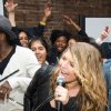 Fergie from The Black Eyed Peas sings with students at the launch of a new Peapod Adobe Youth Voices Academy in New York, Tuesday, April 19, 2011. (AP Photo/Charles Sykes)