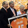 Photo -   Former Tennessee player and head coach Johnny Majors, center, stands with Chancellor Jimmy Cheek, left, and his wife Mary Lynn Majors after his No. 45 jersey was retired before an NCAA college football game between Florida and Tennessee, Saturday, Sept. 15, 2012, in Knoxville, Tenn. (AP Photo/Wade Payne)