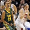 Photo - South Florida's Courtney Williams, left, reacts during the second half of an NCAA college basketball game against Louisville in the semifinals of the American Athletic Conference women's tournament, Sunday, March 9, 2014, in Uncasville, Conn. Louisville won 60-56. (AP Photo/Jessica Hill)