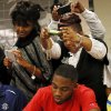 Eric Davis has his photo taken by his mother, Sheri Davis, as his father, C.J. Davis takes a photo above her during the signing day ceremony at Edmond Santa Fe High School in Edmond, Okla., Wednesday, Feb. 6, 2013. Davis will play football at Northwestern Oklahoma State University. Photo by Nate Billings, The Oklahoman