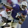 Oklahoma\'s Keenan Clayton (22) stops Washington\'s D\'Andre Goodwin (11) in the first half during the college football game between Oklahoma and Washington at Husky Stadium in Seattle, Wash., Saturday, September 13, 2008. BY NATE BILLINGS, THE OKLAHOMAN