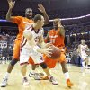 Syracuse\'s Paul Harris (11) and Rick Jackson (00) defends on Oklahoma\'s Taylor Griffin (32) who looks to pass the ball to Austin Johnson (20) during the first half of the NCAA Men\'s Basketball Regional at the FedEx Forum on Friday, March 27, 2009, in Memphis, Tenn. PHOTO BY CHRIS LANDSBERGER, THE OKLAHOMAN