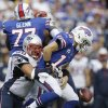 Photo -   Buffalo Bills' Ryan Fitzpatrick (14) is sacked by New England Patriots' Rob Ninkovich (50) during the second half of an NFL football game in Orchard Park, N.Y., Sunday, Sept. 30, 2012. Fitzpatrick recovered the fumble. (AP Photo/Gary Wiepert)