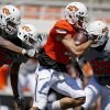 OSU\'s Charlie Moore runs past Jimmy Bean, left, Miketavius Jones, and Cameron Gravelle, right, on his way to a touchdown during Oklahoma State\'s spring football game at Boone Pickens Stadium in Stillwater, Okla., Saturday, April 21, 2012. Photo by Bryan Terry, The Oklahoman