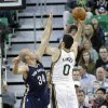 Photo - Utah Jazz's Enes Kanter (0) shoots as New Orleans Pelicans' Greg Stiemsma (34) defends in the first quarter during an NBA basketball game on Friday, April 4, 2014, in Salt Lake City. (AP Photo/Rick Bowmer)