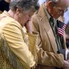 MILITARY DEPLOYMENT / JOHNNY TAYLOR OKLAHOMA CITY ARENA: Johnny and Gerene Taylor, of Hugo, Okla., bow their heads in prayer during a deployment ceremony for members of the 45th Infantry Brigade Combat Team at The OKC Arena in Oklahoma City on Wednesday, Feb. 16, 2011. The Taylors went to the event to see their grandson Blake Whitbeck, who will be deployed. Photo by John Clanton, The Oklahoman