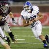 Deer Creek\'s Brennan Miyake (20) tries to get past Edmond Memorial\'s Jason Hand (32) on a carry during a high school football game between Edmond Memorial and Deer Creek at Wantland Stadium in Edmond, Okla., Thursday, Sept. 13, 2012. Photo by Nate Billings, The Oklahoman