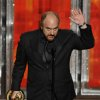 Louis C.K. accepts the award for outstanding writing in a comedy series to for