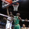 Oklahoma City\'s Kendrick Perkins (5) shoots a lay up as Boston\'s Kevin Garnett (5) defends during the NBA game between the Oklahoma City Thunder and the Boston Celtics at the Chesapeake Energy Arena in Oklahoma City, Sunday, March 10, 2013. Photo by Sarah Phipps, The Oklahoman