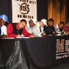 Eight Midwest City High School football players signed letters of intent at Midwest City High School Tuesday, February 1, 2012. Left to right, James Flanders signed with The University of Tulsa, Zeke Lewis with The University of South Dakota, Devin Crisp with Northeastern Oklahoma State, Dakota Moran with Northeastern Oklahoma State, Ronnie Davis with Northeastern Oklahoma State, Rickey Reeves with the University of South Dakota, Myles Hogg with Southern Nazarene University and CJ Smith with Emporia State University. PHOTO BY HUGH SCOTT, FOR THE OKLAHOMAN ORG XMIT: KOD