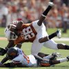 Oklahoma State\'s Brodrick Brown (19) tackles Texas\' D.J. Monroe (26) during first half of a college football game between the Oklahoma State University Cowboys (OSU) and the University of Texas Longhorns (UT) at Darrell K Royal-Texas Memorial Stadium in Austin, Texas, Saturday, Oct. 15, 2011. Photo by Sarah Phipps, The Oklahoman