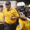 Photo - Wyoming head coach Craig Bohl leads his team onto the field before facing Montana in a NCAA college football game on Saturday, Aug. 30, 2014, at War Memorial Stadium in Laramie, Wyo. (AP Photo/Casper Star-Tribune, Ryan Dorgan)
