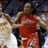 Photo - Mississippi guard Valencia McFarland (3) drives against Tennessee guard Andraya Carter (14) during the second half of an NCAA college basketball game Thursday, Jan. 9, 2014, in Knoxville, Tenn. Tennessee won 94-70. (AP Photo/Wade Payne)