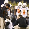 OSU\'s Dez Bryant sits on the field after an injury during the Holiday Bowl college football between Oklahoma State and Oregon at Qualcomm Stadium in San Diego, Tuesday, Dec. 30, 2008. PHOTO BY BRYAN TERRY, THE OKLAHOMAN.