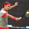 Photo - Swiss Roger Federer returns the ball to Portugal's Joao Sousa during the ATP tennis tournament in Halle, Germany, Thursday, June 12, 2014. Federer won the match with 6-7, 6-4 and 6-2. (AP Photo/dpa, Oliver Krato)