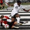 Edmond North\'s Courtney Dike, right, falls down over Bishop Kelley\'s Darienne Chapman during the girls 6A state championship soccer game in Newcastle, Okla., Friday, May 11, 2012. Photo by Bryan Terry, The Oklahoman