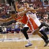 Milwaukee Bucks\' Brandon Knight (11) drives to the basket while being guarded by Philadelphia 76ers\' Michael Carter-Williams, right, during the first half of an NBA basketball game, Monday, Feb. 24, 2014, in Philadelphia. (AP Photo/Chris Szagola)
