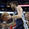 Mephis Grizzlies center Marc Gasol is fouled by Toronto Raptors center Jonas Valanciunas during the first half of an NBA basketball game in Toronto on Wednesday, Feb. 20, 2013. (AP Photo/The Canadian Press, Frank Gunn)