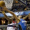 Washington Wizards Kevin Seraphin (13) blocks Orlando Magic power forward Gustavo Ayon (19) from scoring during the second quarter of an NBA basketball game at the Verizon Center in Washington, Friday, Dec. 28, 2012. (AP Photo/Jacquelyn Martin)