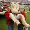 Sooner fans Tyler and Brittany Raimey of Fort Worth, pose with the Sooner mascot before the college football game between the University of Oklahoma Sooners (OU) and the Texas Christian University Horned Frogs (TCU) at Amon G. Carter Stadium in Fort Worth, Texas, on Saturday, Dec. 1, 2012. Photo by Steve Sisney, The Oklahoman