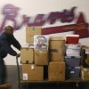 Photo - Dannan Edison, from Atlanta Peach Movers, helps pack and load Atlanta Braves baseball equipment for the trip south for spring training Friday, Feb. 7, 2014, in Atlanta. (AP Photo/Atlanta Journal-Constitution, Bob Andres)  MARIETTA DAILY OUT; GWINNETT DAILY POST OUT; LOCAL TV OUT; WXIA-TV OUT; WGCL-TV OUT