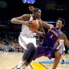 Oklahoma City\'s Kevin Durant (35) gets by Phoenix Josh Childress (1) during the NBA basketball game between the Oklahoma City Thunder and the Phoenix Suns, Sunday, Dec. 19, 2010, at the Oklahoma City Arena. Photo by Sarah Phipps, The Oklahoman