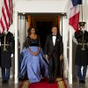 Photo - First lady Michelle Obama, left, and President Barack Obama wait for the arrival of French President François Hollande for a State Dinner at the North Portico of the White House on Tuesday, Feb. 11, 2014, in Washington. (AP Photo/ Evan Vucci)