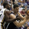 Brooklyn Nets\' Brook Lopez, right, drives on Utah Jazz\'s Paul Millsap during the first half of an NBA basketball game, Saturday, March 30, 2013, in Salt Lake City. (AP Photo/George Frey)