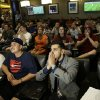 United States fan Arin Khodabakhshian reacts at the MGM Grand sports book in Las Vegas as he watches the final seconds of the U.S. 1-0 loss to Germany during their World Cup soccer match Thursday, June 26, 2014. (AP Photo/John Locher)