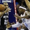Charlotte Bobcats\' Brendan Haywood (33) and San Antonio Spurs\' Tim Duncan (21) battle for a rebound during the first half of an NBA basketball game in Charlotte, N.C., Saturday, Dec. 8, 2012. (AP Photo/Chuck Burton)