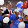 Photo -   Republican presidential nominee Mitt Romney watches as balloons fall around him and his wife Ann during the Republican National Convention in Tampa, Fla., on Friday, Aug. 31, 2012. (AP Photo/Patrick Semansky)