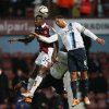 Photo - West Ham's Carlton Cole, left goes to head the ball with Manchester City's Joleon Lescott during the second leg of the English League Cup semifinal soccer match between West Ham United and Manchester City in London, Tuesday, Jan. 21, 2014. (AP Photo/Alastair Grant)