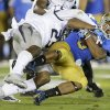 Nevada defensive back Alex Mack, left, brings down UCLA running back Jordon James during the first half of an NCAA college football game in Pasadena, Calif., Saturday, Aug. 31, 2013. (AP Photo/Chris Carlson)