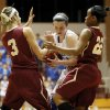 Mount St. Mary\'s Kaely Bond (21) gets caught between Byng\'s Alexis Hill (3) and Mackenzie Hudson (22) during a Class 4A girls high school basketball game in the first round of the state tournament at the Sawyer Center on the campus of Southern Nazarene University in Bethany, Okla., Thursday, March 7, 2013. Photo by Nate Billings, The Oklahoman